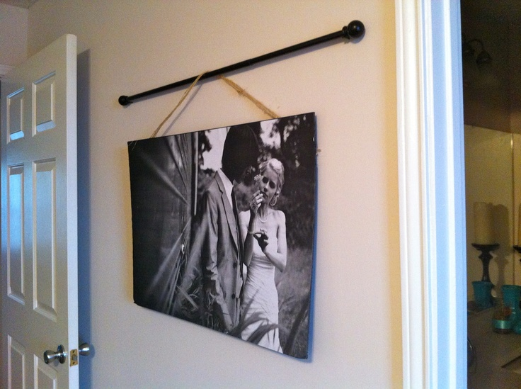 """At FedEx, ask for an """"engineer's print"""" of your picture (bring on a jump drive) = $2.50. Use spray adhesive to glue to black, thick/foam poster board = 6-12 dollars depending on the size. You can ask for a print up to 3x4 feet. This one is about 1.5x2.5 ft. Hot glue twine on the back and hang from a curtain rod.  Original credit to: www.sugarbeecraft..."""