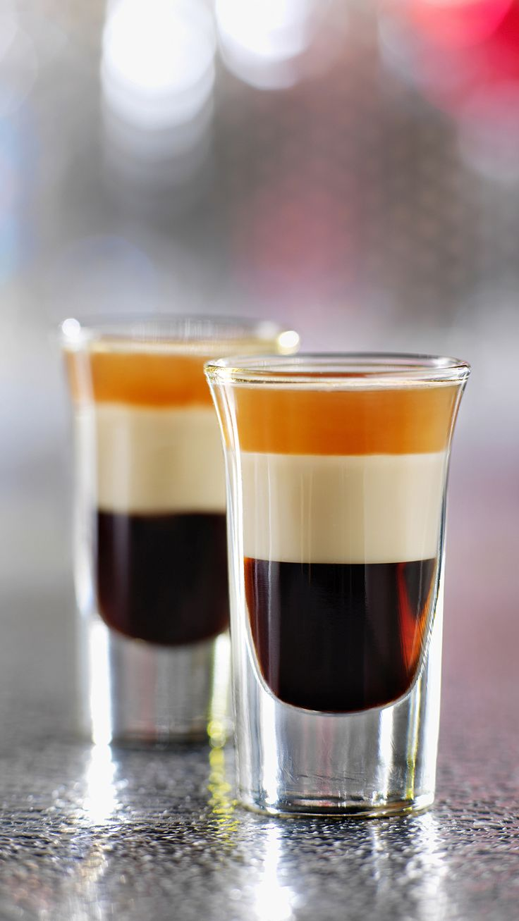 B-52 shooter ---- This drink is more about the layering technique than the specific recipe  1/3 ounce Kahlua or Tia Maria ; 1/3 ounce Bailey's Irish Cream & 1/3 ounce Grand Marnier (some people use amaretto instead). In that order.  Pour the Kahlua into a shot glass, then layer Bailey's, and then Grand Marnier.  Cocktail type drink