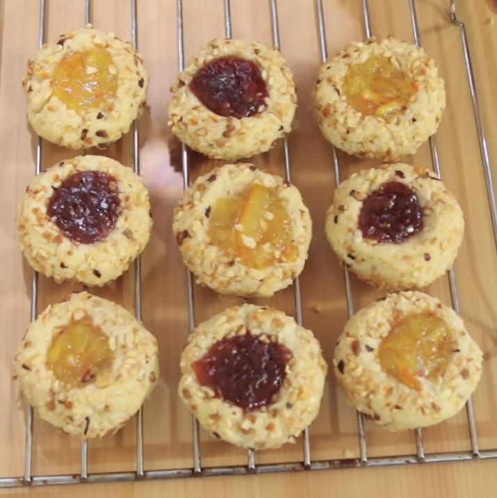 This classic holiday cookie is so fun to make and fill with your favorite toppings! Thumbprint cookies are rolled in nuts and topped with a yummy spread.