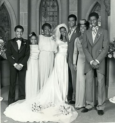 """The cast of """"Good Times"""" from left to right: Michael Evans (Ralph Carter), Penny Woods (Janet Jackson), Florida Evans (Esther Rolle), Thelma Evans (Bernadette Stanis), Keith Anderson (Ben Powers), Willona Woods (Ja'net DuBois) and J.J. Evans (Jimmie Walker)"""