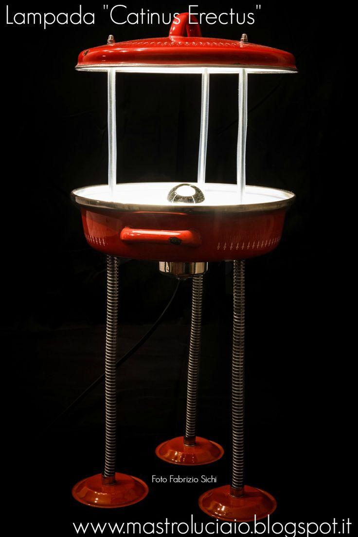 """Catinus Erectus"" lamp, made with a red metal saucepan, springs, red metal small plates. #saucepan #red #lamp #vintage #redesign #handicraft #recycle #reuse #artigianato #lampade #lights #luci #handmade"