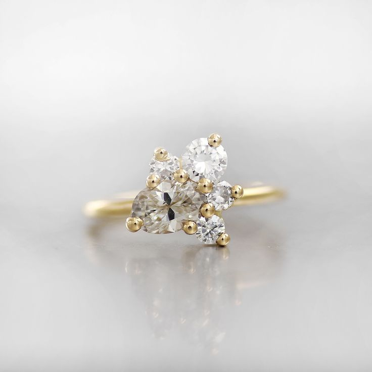 This cluster engagement rings showcases a variety of different shaped color, size, and shape diamonds!