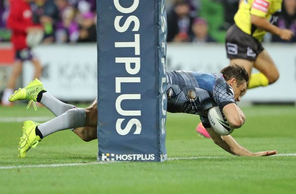 Cooper Cronk Photos Photos - Cooper Cronk of the Melbourne Storm scores a try during the round five NRL match between the Melbourne Storm and the Penrith Panthers at AAMI Park on April 1, 2017 in Melbourne, Australia. - NRL Rd 5 - Storm v Panthers