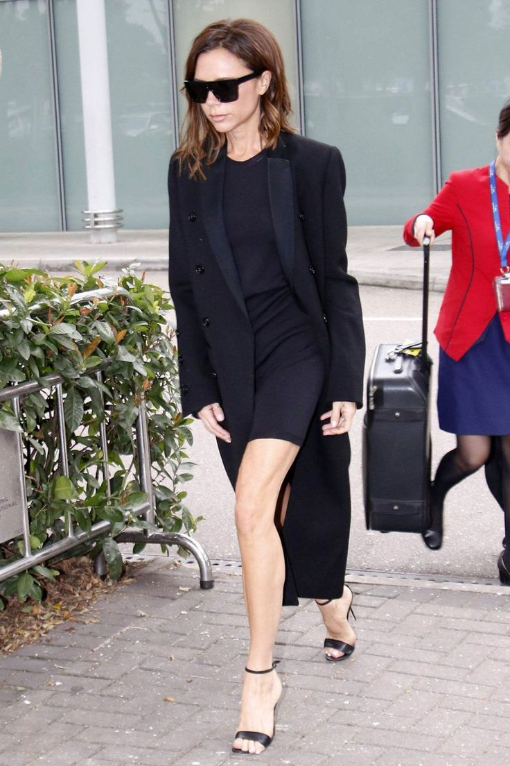 Victoria Beckham in her own design out in Hong Kong. #bestdressed