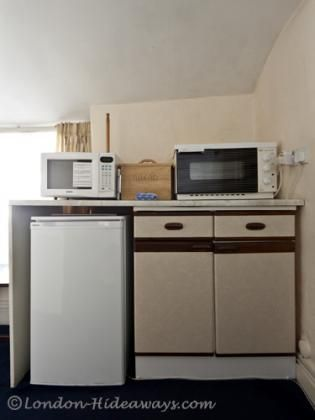 Kitchen facilities - Small fridge ,Microwave ,Hot plates, Percolator ,Kettle ,Toaster ,Dinnerware and cookware provided