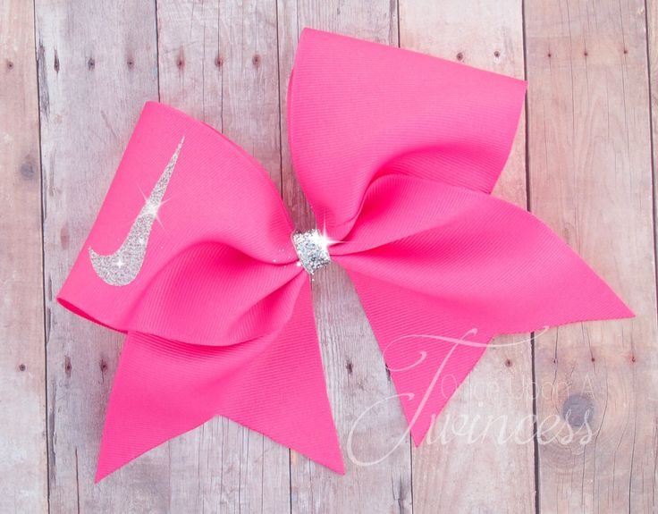 """This Nike cheer bow is made with high quality US made 3"""" grosgrain ribbon. The swoosh is made with sparkly silver glitter vinyl. This has 1 layer of ribbon and is sprayed with stiffener in order to ke"""