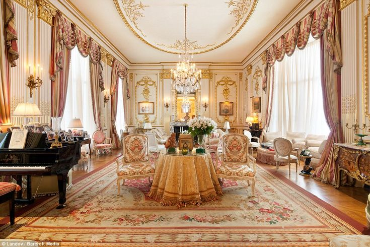 Opulent: The drawing room in Joan Rivers's Upper East Side condo is a sea of pink and gold velvet, with a piano in the corner, lit by three glittering chandeliers