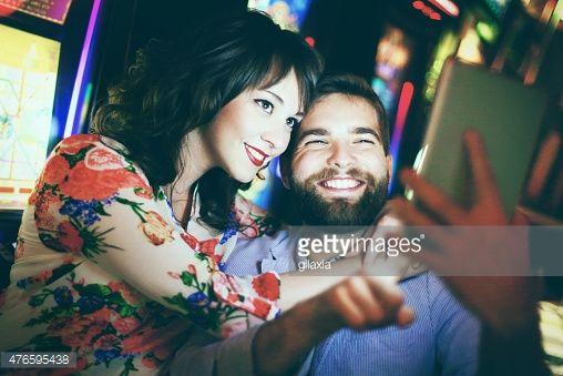 People taking selfies in casino. : Stock-Foto