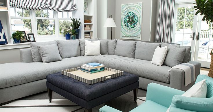The cool neutrals in this Coastal Living Family Space are paired with accents of blue to create a subtle but sophisticated beach atmosphere.