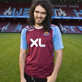 Does anyone notice how absolutely creepy Russell Brand looks in this photo?