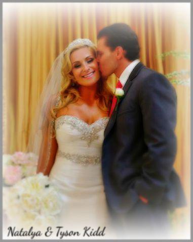 TJ Wilson kisses his new bride Nattie Neidhart-Wilson