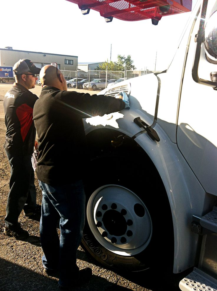 """Side Effects Graphics gets ready to start on the installation of graphics onto an Elliot Crane Truck. The newest member of TekSign's fleet: """"Dorothy Ann"""" will be the first to be wrapped up with the new graphic designs."""