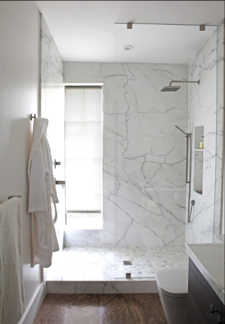 In California Wine Country, A Modern Farmhouse for a Brit and a Texan - Remodelista. The shower in the guest bathroom has walls of solid Calacatta Oro marble, and the same stone in mosaic square on the shower floor.