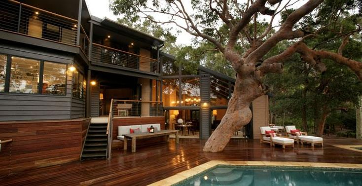 Surrounded by ancient angophoras and with views through eucalypts down to the sparkling Brisbane Waters, Pretty Beach House is a super-sophisticated private guesthouse in a magical setting...via http://www.bellsatkillcare.com.au/pretty-beach-house/pretty-beach-house.html