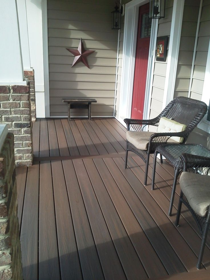 Some Front Porch Floor Ideas For Your Inspiration : Attractive Image Of Front Porch Decoration Using Single Red Wood Front Door Including Black Wicker Front Porch Armchair And Dark Brown Solid Wood Front Porch Flooring