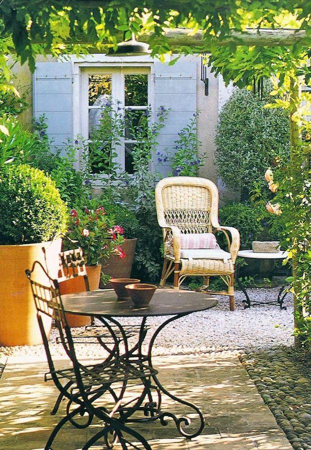 Sunny garden patio in Provence, France \u2022 original source not found