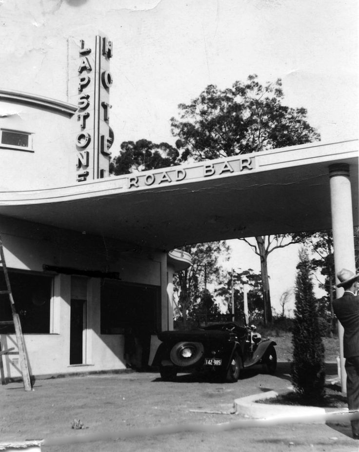 Notes: In the 1930s the Art Deco styled Lapstone Hotel became a fashionable place to stay and a road house bar was built at the entrance to cater for passing traffic. However there is no indication that it ever operated as a drive through bottle shop.   Format: B&W photo  Date Range: 1930s  Licensing: Attribution, share alike, creative commons. .  Repository: Blue Mountains City Library www.bmcc.nsw.gov.au/yourcommunity/library  Part of: Local Studies Collection - LS Images  Provenance: BMCC…
