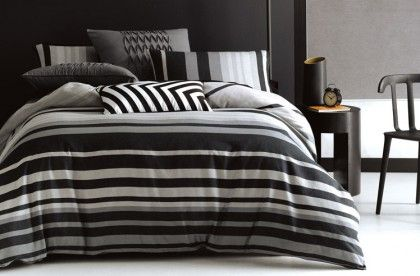 Deco Liverpool Quilt Cover Set. This smart masculine stripe is woven in grey marl and black cotton for industrial chic. Printed texture reverse with black piping finish.