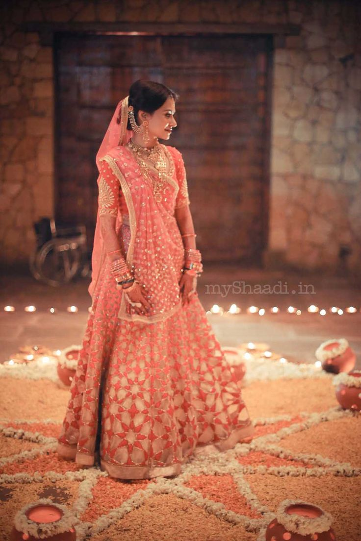 Indian bride wearing bridal lehenga and jewelry. #IndianBridalHairstyle #IndianBridalMakeup #IndianBridalFashion