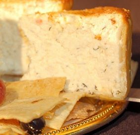 Savory Herbed Cheesecake has an elegant, crisp parmesan and rosemary crust which makes a pleasant complimentary flavor. It is impressive on the buffet.