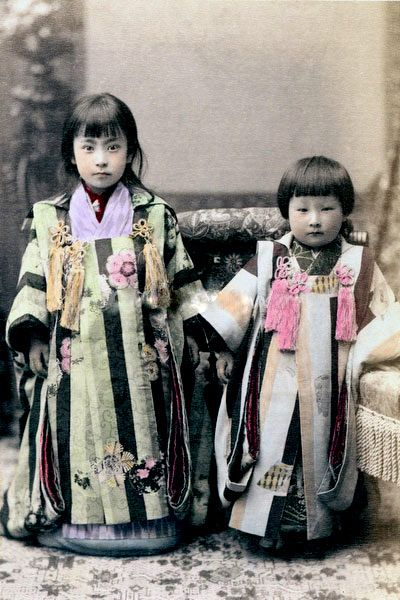 Photo of two young girls in ceremonial dress. Late 19th - early 20th century, Japan.