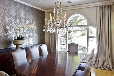 Beautiful dining room with metallic accent wallpaper