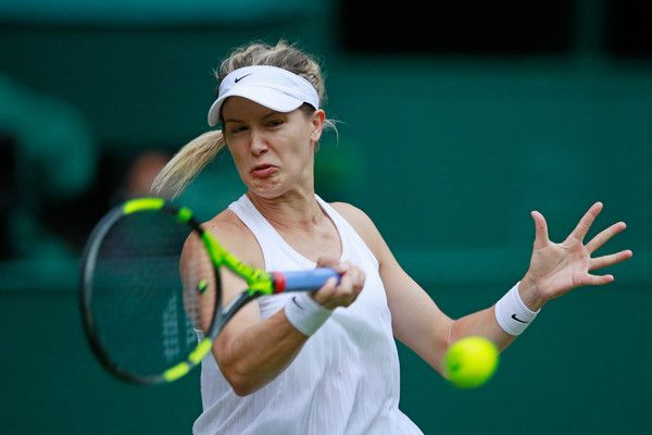Eugenie Bouchard Photos Photos - Eugenie Bouchard of Canada plays a forehand during the Ladies Singles second round match against Johanna Konta of Great Britain on day four of the Wimbledon Lawn Tennis Championships at the All England Lawn Tennis and Croquet Club on June 30, 2016 in London, England. - Day Four: The Championships - Wimbledon 2016