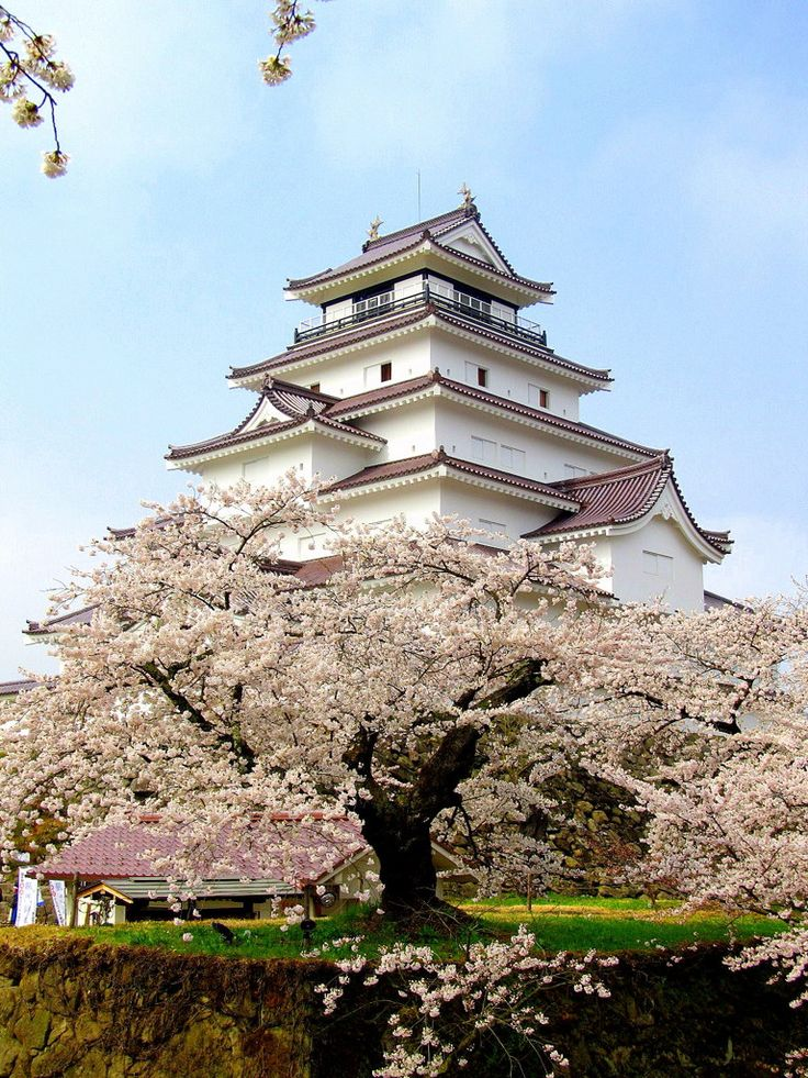 Tsuruga Castle ( 鶴ヶ城 ), also known as Aizuwaka-Wakamatsu Castle ( 会津若松城 ), is a concrete replica of a traditional Japanese castle in northern Japan, at the center of the city of Aizuwakamatsu, in Fukushima Prefecture. The original castle was destroyed in the Battle of Aizu by the forces of the newly formed Imperial army in 1868 during the Boshin War, at the eve of the restoration era.