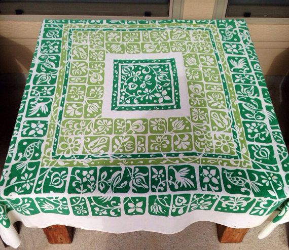Super vibrant kelley green and light green tablecloth. The colors are so bright and happy in this linen. It measures 51x46 and is made of a