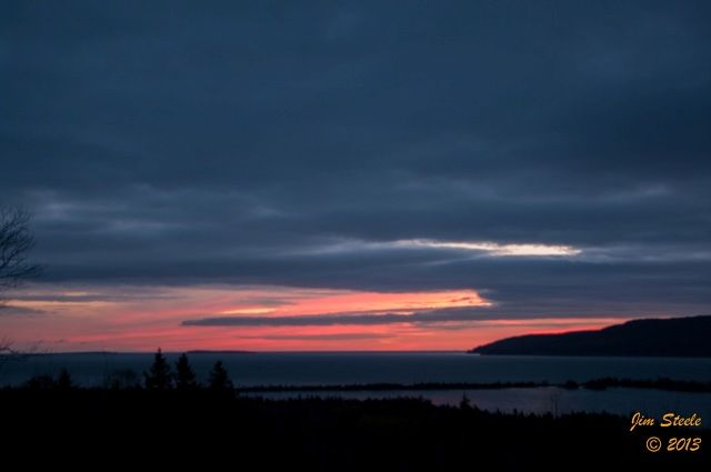 A dark and cloudy morning with a splash of colour in Cape Breton. Jim Steele captured this shot for us at 6:27 AM. Enjoy!