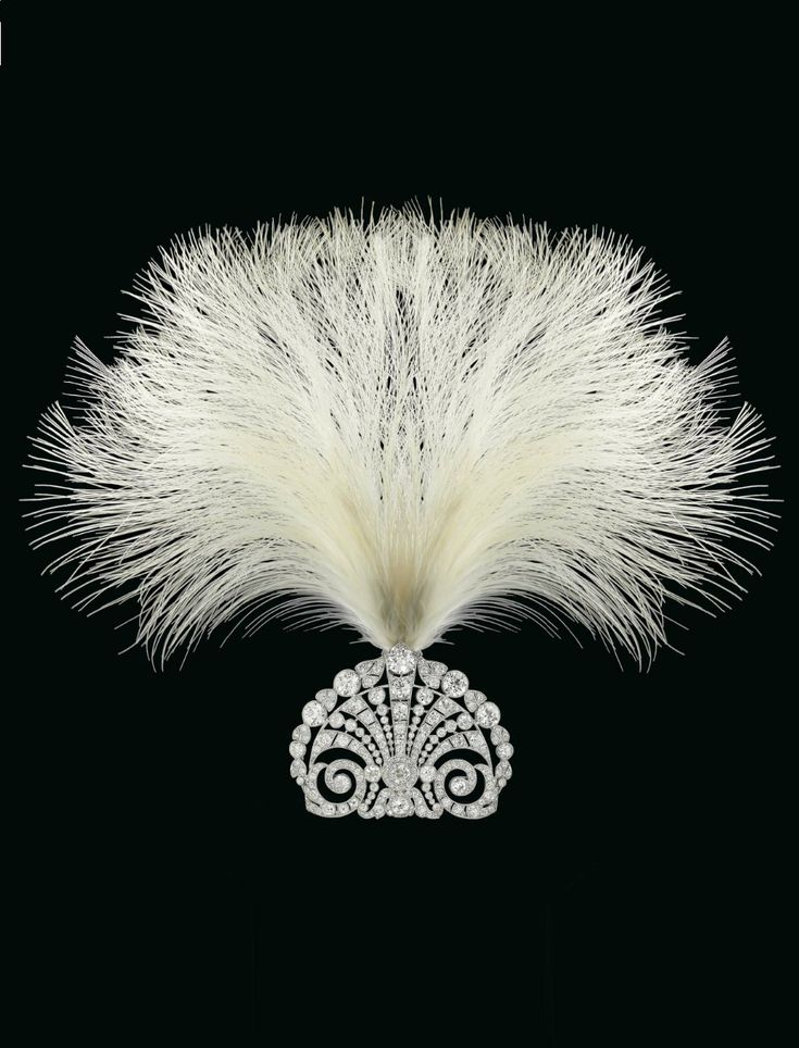 AN ART DECO DIAMOND TIARA, 1920S. The pierced plaque of foliate design, set throughout with old-cut diamonds, to the later gallery and frame, 1920s, 6.3 cm.