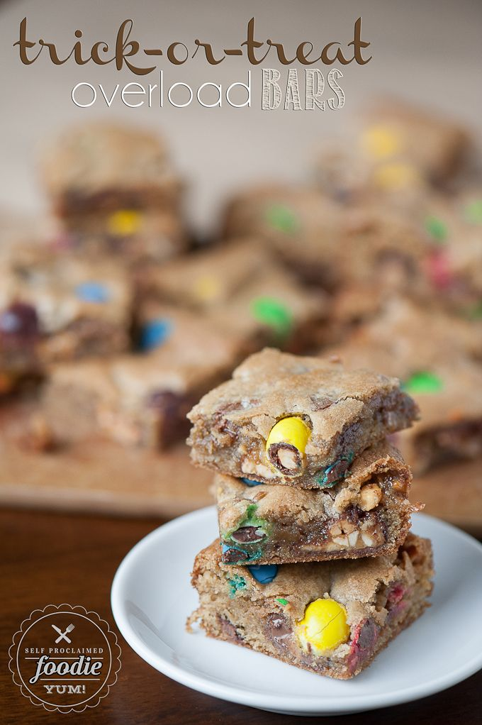 These Trick-or-Treat Overload Bars are the best use for leftover Halloween candy, insanely delicious, and an easy to make cookie bar dessert treat. {Self Proclaimed Foodie}