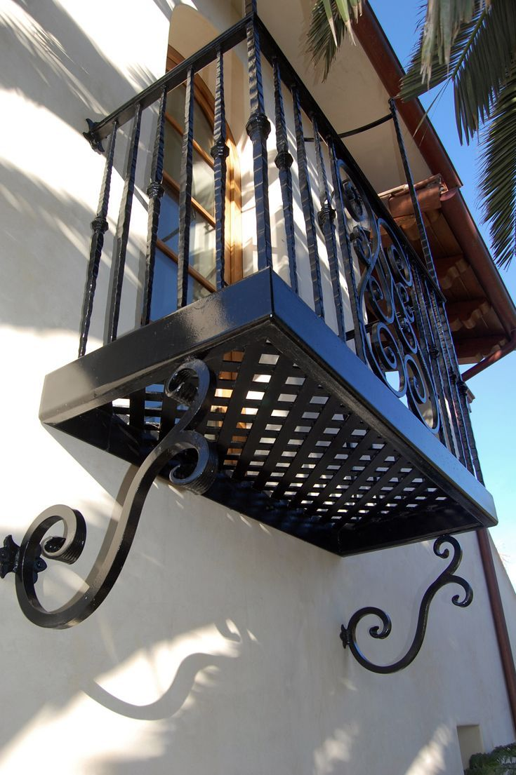 Front Exterior: Spanish architecture, Spanish colonial architecture, Spanish style, Mexican architecture, Mission architecture, Spanish Baroque, old world style,  tile roof, detailed fascia, wood overhang, wood eave, smooth stucco, wood corbels, French doors, wood window, balcony, wrought iron railing, wrought iron, decorative iron, exterior wall sconce light.