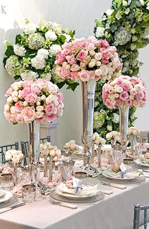 KJ409 gorgeous stunning centre pieces. Love the silver vases so opulent.