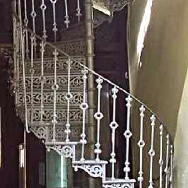 A Cast Iron Spiral Staircase Clearly Showing The Central Newel Post That Supports Treads Risers And Balustrade