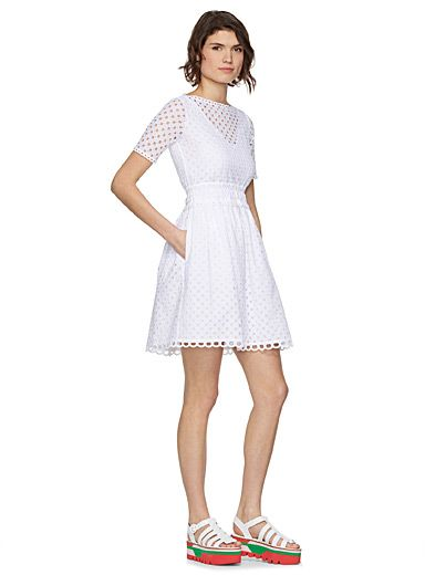 This dress fully captures the Carven line's defining air of innocence and the pretty schoolgirl style cherished by Carmen de Tommaso. The new creative directors behind the famous Parisian label unveil a stylish and fashionable collection. This ravishing dress is perfect for any occasion.    English embroidery, full cotton lining   Scalloped finish on the collar, sleeves, waist and hem   Tunnelled elastic waist, side pockets   Hidden zip closure at back    The model is wearing size 36
