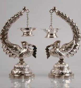 Silver peacock shaped oil lamps