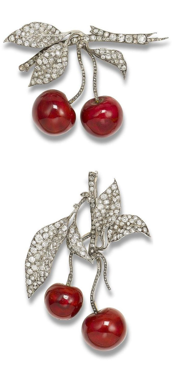 A nineteenth-century pair of diamond and enamel 'cherry' brooches; cherries can symbolise sweetness.