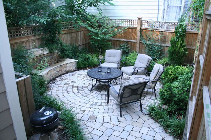 Tiny courtyard supplied with grill, water feature, fire pit, lights and garden.