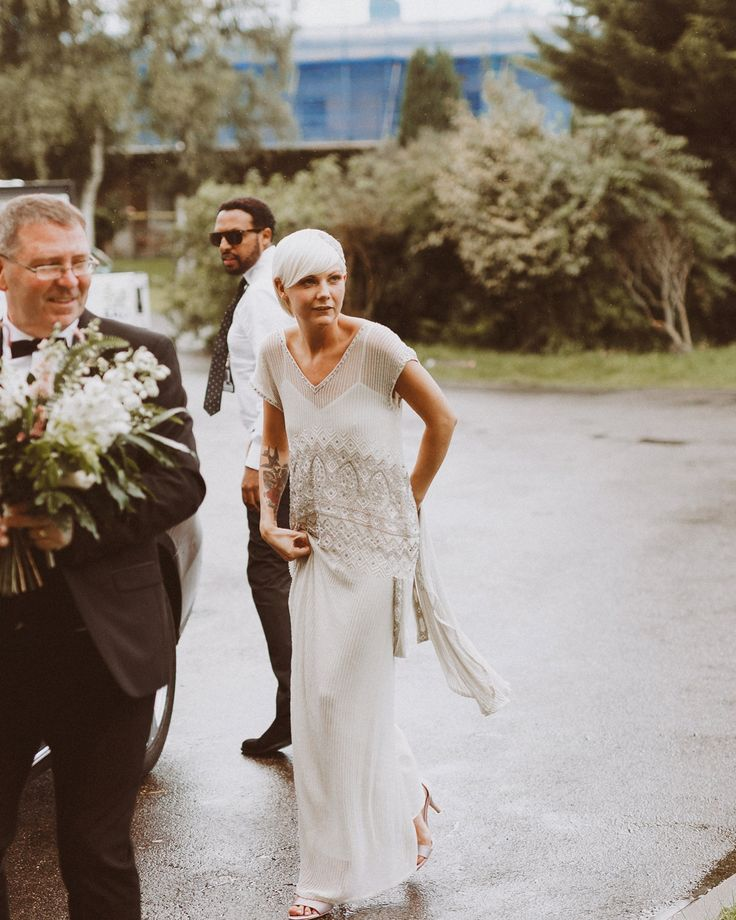 Bride wears a beaded Eliza Jane Howell gown. Images by Emily & Steve Photography