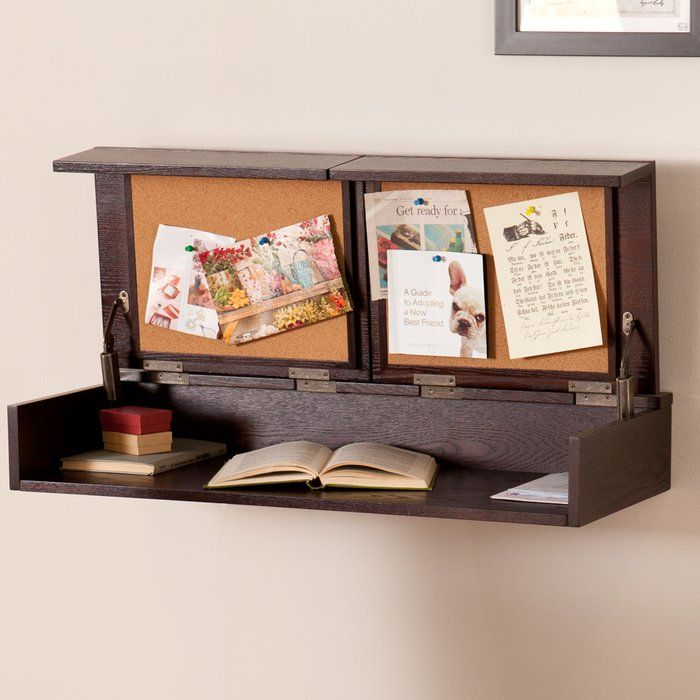 This double duty wall mount desk and shelf tucks away clutter with a split-top that lifts independently, revealing a broad workspace for tidying office accessories or small electronics. Two corkboards pin up to-do lists to keep you on task and the transitional design blends well with any decor. Hang this custom height home office to shelve chaos or keep it closed for maximum display space. Anywhere you hang it, organization awaits!