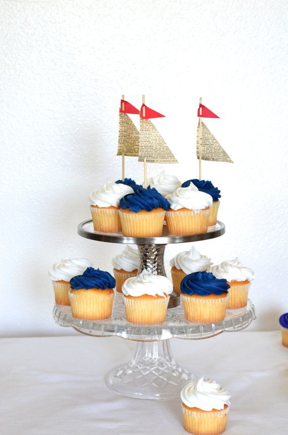 Come sail away with these charming handmade sailboat toppers - each topped with a tiny little red flag! We make each sail topper from vintage book paper, cardstock and a 6 bamboo pick, making them a delightful way to turn your cupcakes into mini sailboats, so cute and definitely a