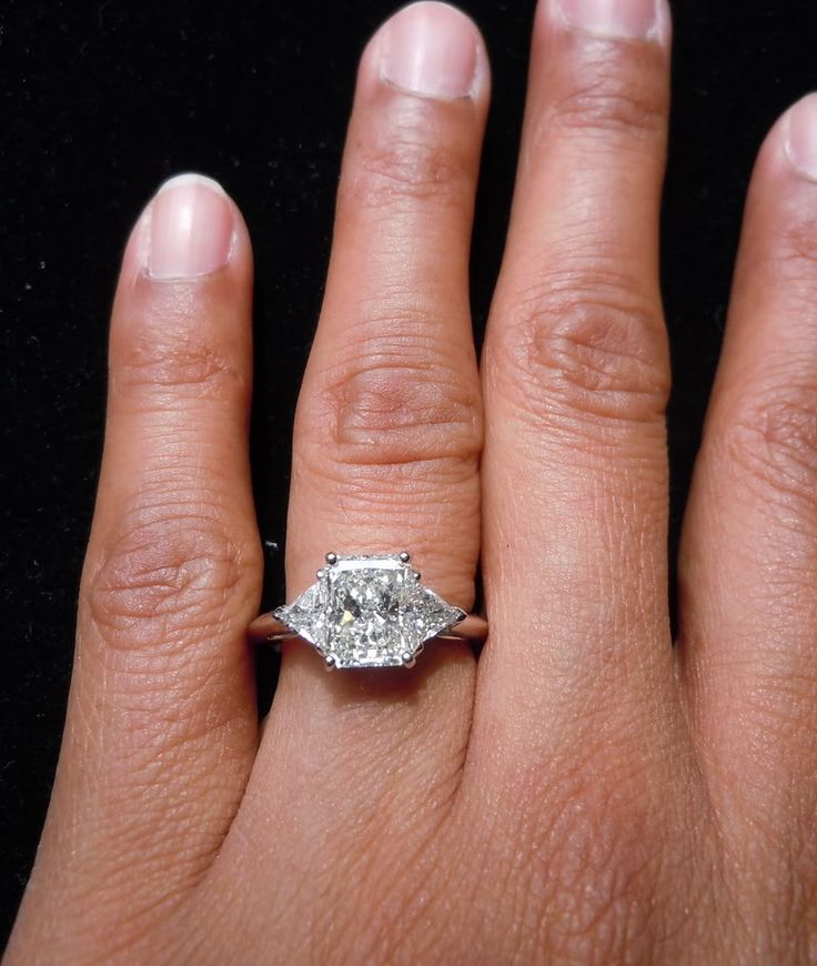 Here's a sensational radiant cut diamond. The shape is a broad rectangle. Perfect for a three stone ring. It looks every bit its 2.06 carats- if not more. The ring has great presence on the finger and has an amazing amount of sparkle from edge to edge. From all other angles you can see how well made this ring is. It has a delicate profile, yet is substantial enough to last a life time. The platinum is well polished and gives off a luxurious feel.