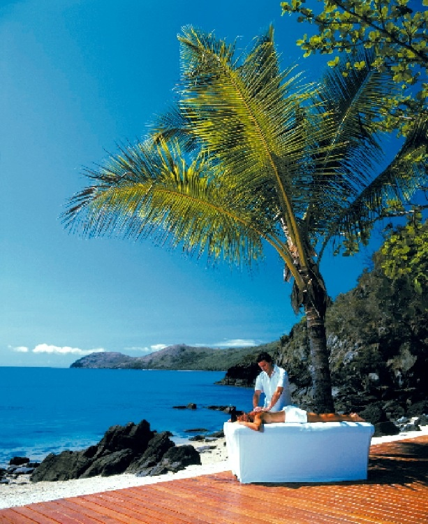 Have an outdoor massage by the beach with the Daydream Island Rejuvenation Spa