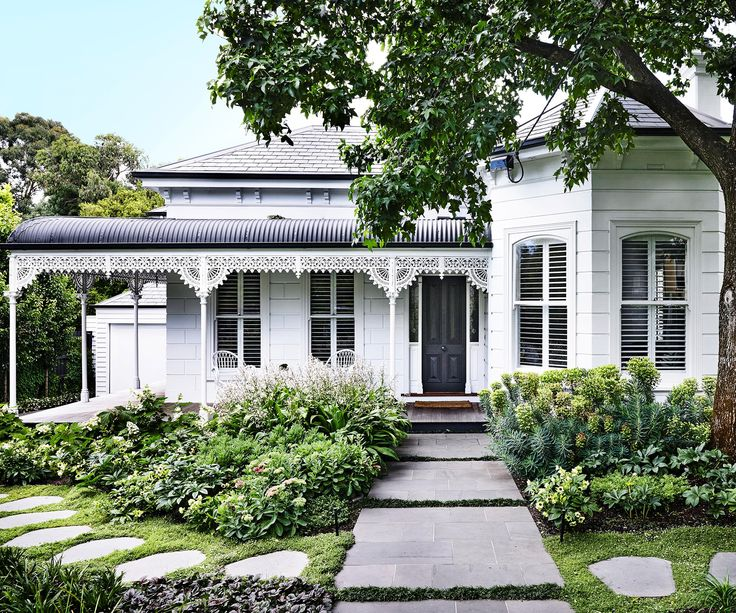 The story of this Victorian garden begins with a giant liquidambar and leads up pathways to family-friendly spaces and richly layered plots.
