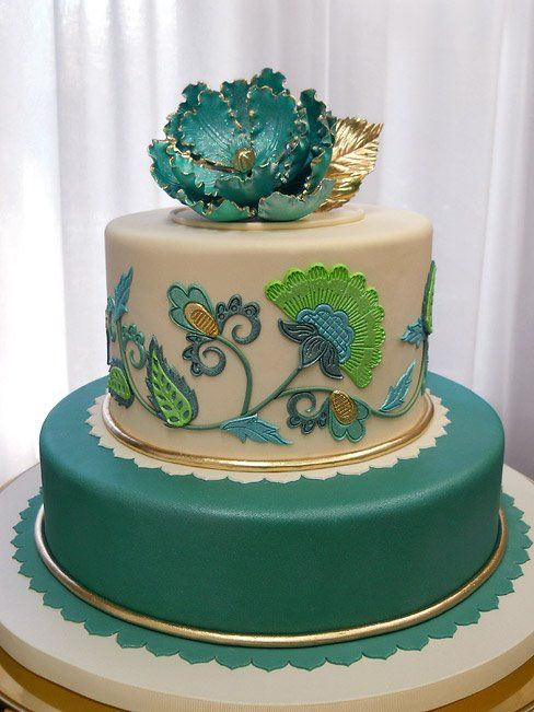 teal cake with green accents