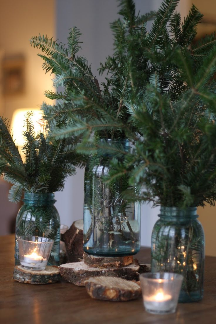 Christmas decor...pine branches in mason jars on wood coasters surrounded by tea lights. Cute idea for table centerpiece! Would work for winter wedding as well