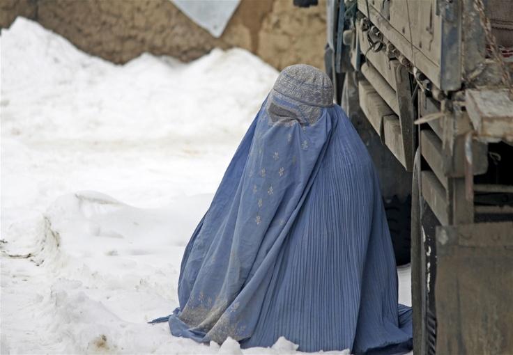 A woman at an informal settlement area for IDPs inside Kabul