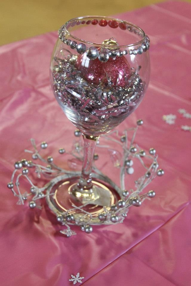 cheap and cute centerpiece dollar store wine glass and foil shreds buy cheap christmas ornaments and drop in it i used some diamond wedding ideas