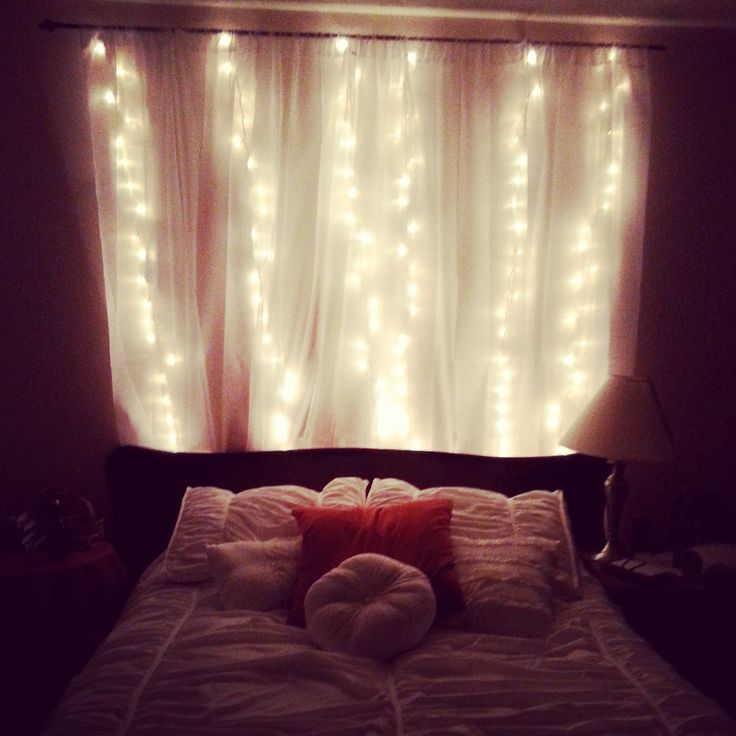 These lights set a romantic tone in the bedroom. Check us out on Facebook at Eros & Psyche's Circle. Twinkly lights. Christmas lights. White lights. Blush, Cora and Rust Bedroom.
